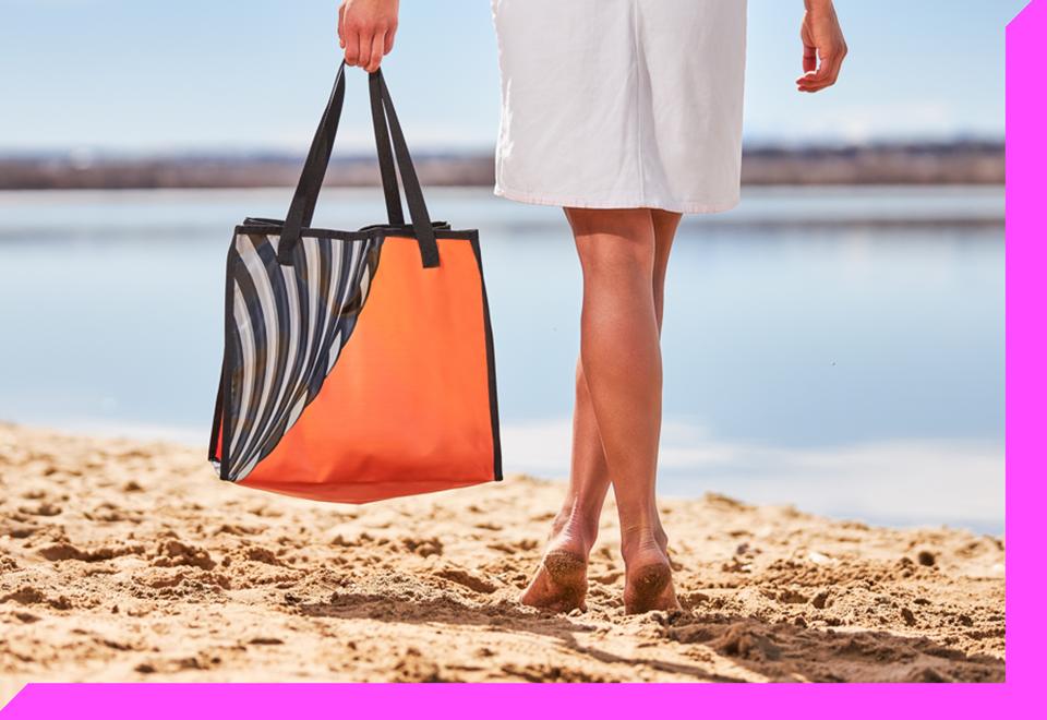 Person carrying orange and zebra stripe vinyl bag